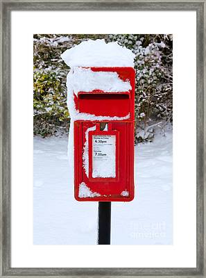 Red Postbox In The Snow Framed Print by Richard Thomas