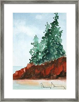 Red Rocks On Waters Edge Framed Print