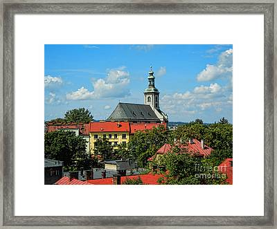 Red Roofed Wonders Framed Print by Mariola Bitner