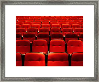 Red Seats Framed Print by Life is but a collection of images.