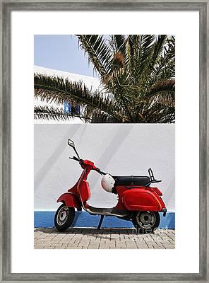 Red Vespa By Wall Framed Print by Sami Sarkis