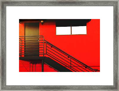 Framed Print featuring the photograph Red Wall by James Bethanis