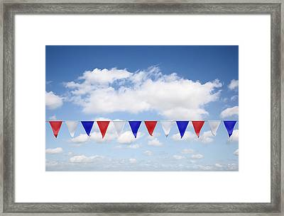 Red, White And Blue Bunting Against A Blue Sky Framed Print by Jon Boyes