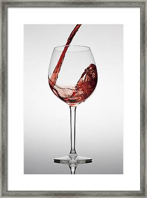 Red Wine Being Poured Into A Glass Framed Print by Dual Dual