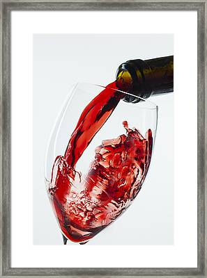 Red Wine Pour Framed Print by Garry Gay
