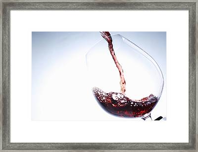 Red Wine Pouring Into Glass Framed Print