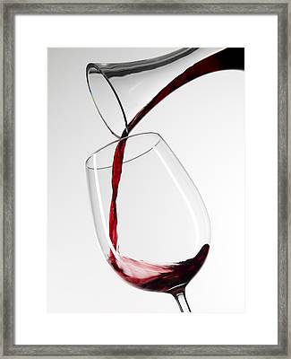 Red Wine Pouring Into Glass From Decanter Framed Print