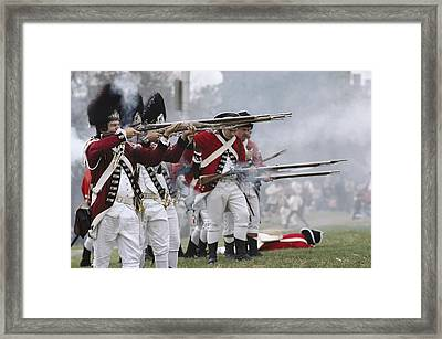 Redcoats Shoot Muskets In A Reenactment Framed Print by Ira Block