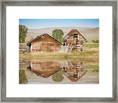 Reflection Of An Old Building Framed Print by Donna Greene