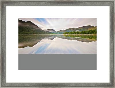 Reflection Of Mountains And Trees On Lake Framed Print by John Ormerod