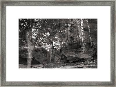 Reflection Of Trees With Rocks And Waterfall Framed Print by Janeen Wassink Searles