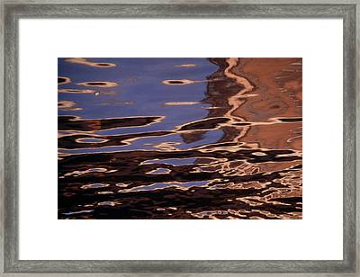 Reflection Patterns In The Waves Framed Print by Paul Damien