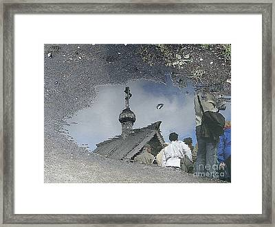 Reflections In A Rain Puddle Framed Print by Louise Peardon