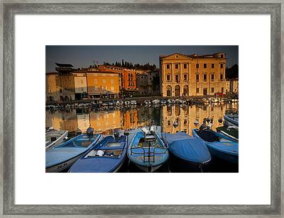 Reflections Of Glowing Buildings Framed Print by Aaron Huey