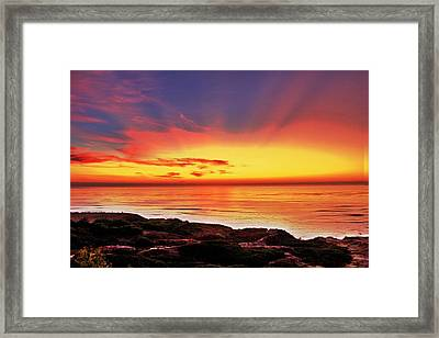 Reflections Of The Setting Sun Framed Print