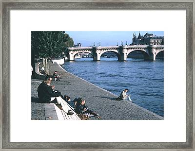 Relaxing Along The Seine Framed Print