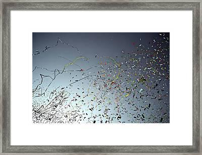 Release Of Confetti Under Blue Sky Framed Print by Jeren (France)