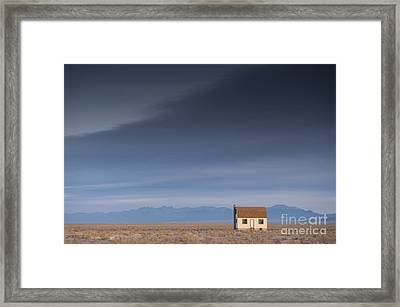 Remote House In Barren Lanscape Framed Print by Dave & Les Jacobs