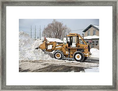 Removing Snow Framed Print by Ted Kinsman