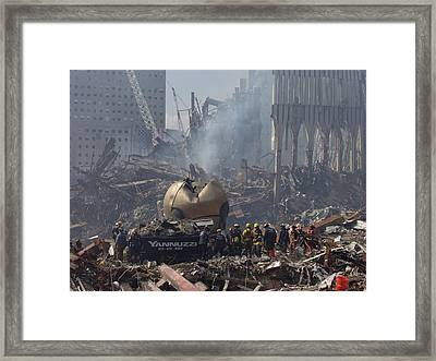 Rescue Crews Amid The Debris Framed Print by Everett