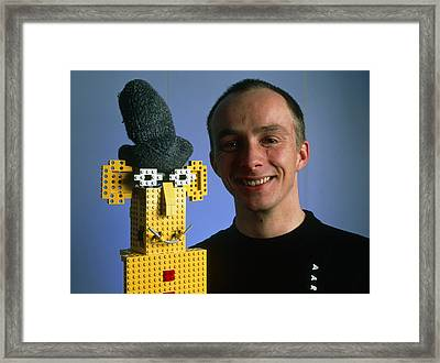 Researcher With His Happy Emotional Lego Robot Framed Print by Volker Steger