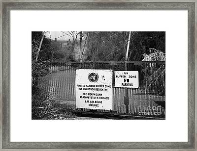 restricted area of the UN buffer zone in the green line dividing north and south cyprus in nicosia Framed Print by Joe Fox