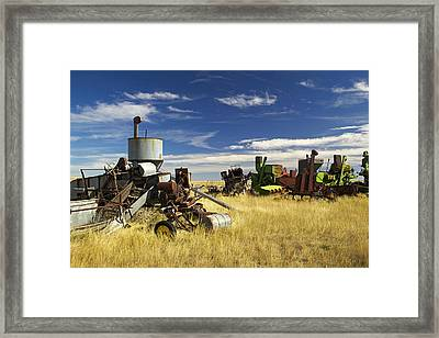 Retired Combines Rust In A Prairie Framed Print by Pete Ryan
