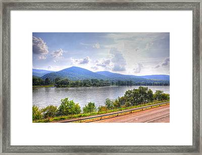 Riding The Train Framed Print by Barry R Jones Jr