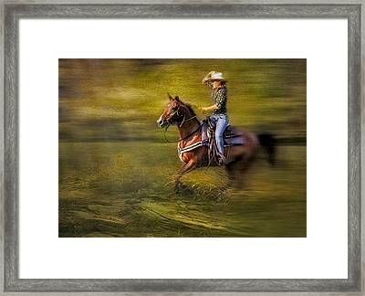 Riding Thru The Meadow Framed Print by Susan Candelario
