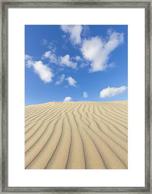 Rippled Sand Dune And Blue Sky With Clouds Framed Print by Rob Kints