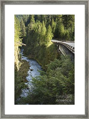 River In Gorge Next To Highway Framed Print by Ned Frisk