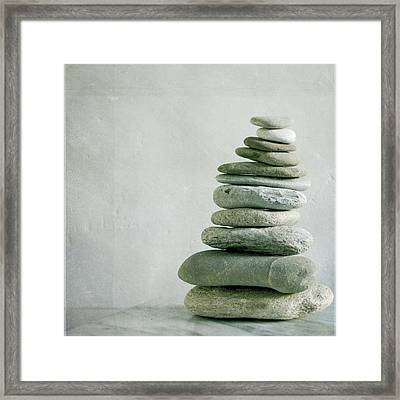 River Pebble Stone Pile Framed Print by Paul Grand Image