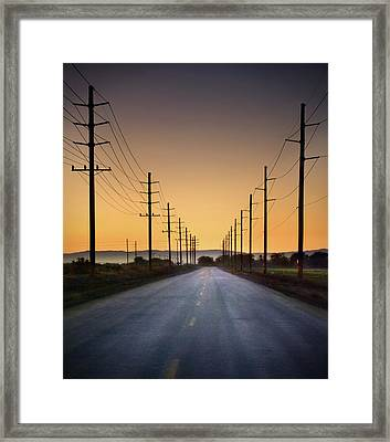 Road And Power Lines At Sunset Framed Print by Www.jodymillerphoto.com