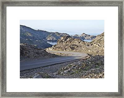 Road And Sea In A Barren Landscape Framed Print