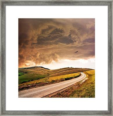 Road Disappearing In Hills Framed Print