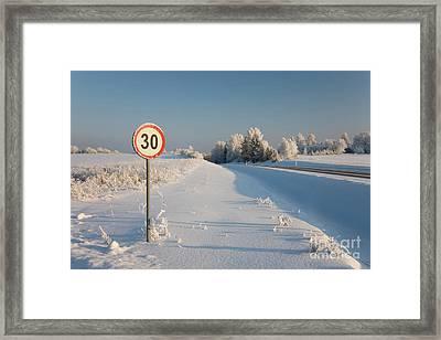 Roadside Sign In Winter Framed Print by Jaak Nilson