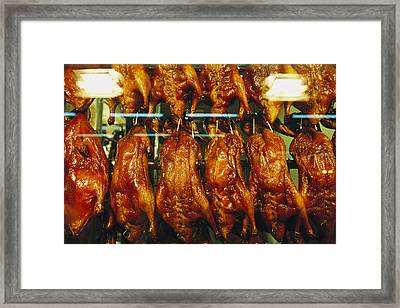 Roasted Ducks And Chickens Framed Print by Justin Guariglia