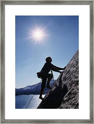 Rock Climber On Polly Dome Above Lake Framed Print