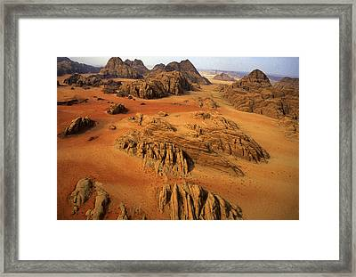 Rock Formations And Sand Near Petra Framed Print by Annie Griffiths
