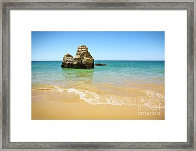 Rock On Beach Framed Print by Carlos Caetano