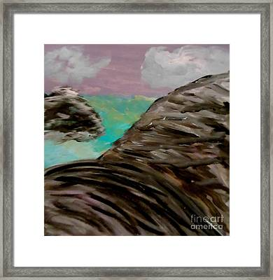Rocks And Water Framed Print by Marie Bulger