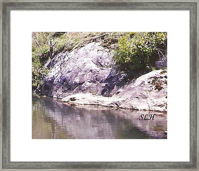 Rocks On The Bank Framed Print