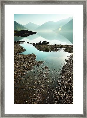 Rocks On The Beach Framed Print by Svetlana Sewell