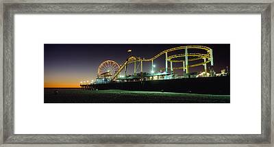 Rollercoaster And Ferris Wheel At Dusk Framed Print by Axiom Photographic