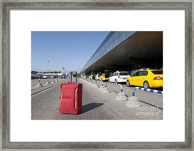 Rolling Luggage Outside An Airport Terminal Framed Print