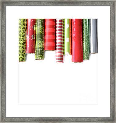Rolls Of Colored Wrapping  Paper On White3 Framed Print by Sandra Cunningham