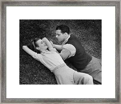 Romantic Couple Lying On Grass, (b&w), Elevated View Framed Print by George Marks