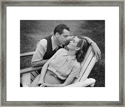 Romantic Couple Relaxing On Deckchair, (b&w) Framed Print by George Marks
