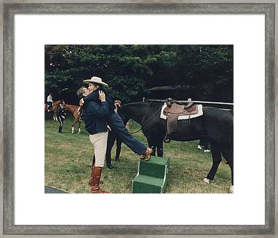 Ronald Reagan Affectionately Assists Framed Print by Everett