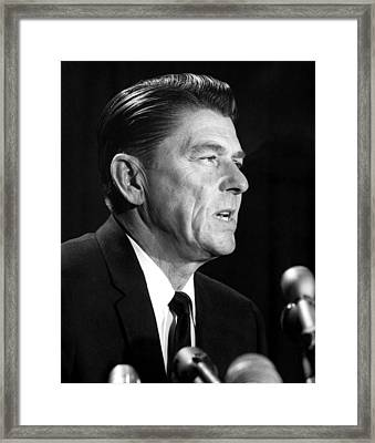 Ronald Reagan At A Press Conference Framed Print by Everett